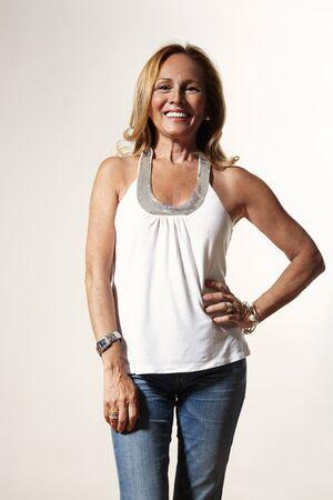 skinny woman: senior woman is looking good, wearing skinny jeans