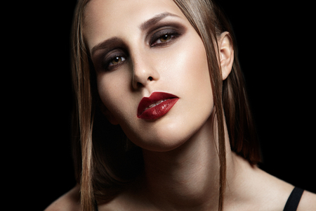 beauty woman with braaces and evening makeup