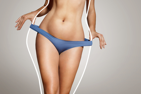 naked belly: loose weight concept, woman with a body lines before loose weight