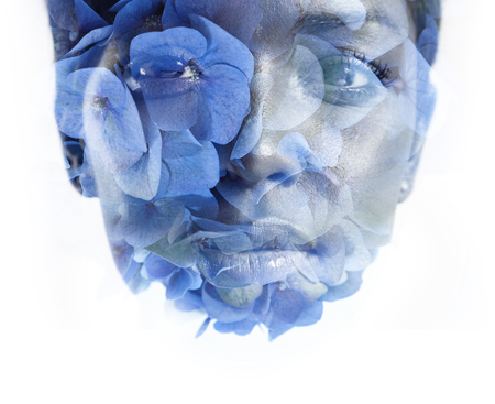 feminine beauty: womans face double exposure with flowers