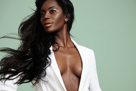 beauty black woman with a blowing hair LANG_EVOIMAGES