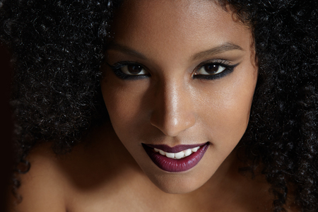 beautiful black woman: pretty latin woman with a curly hair