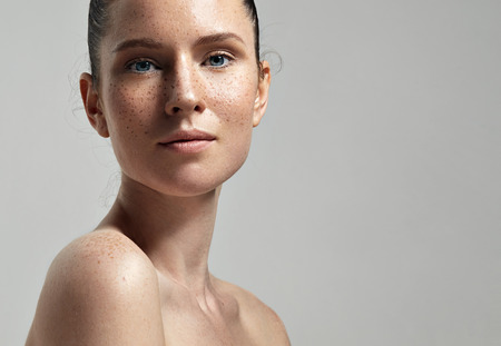freckles woman's face portrait with healthy skin Stok Fotoğraf
