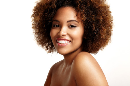 happy black woman with round afro hair and ideal skin