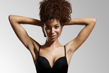 armpits: black woman hands up showing armpits