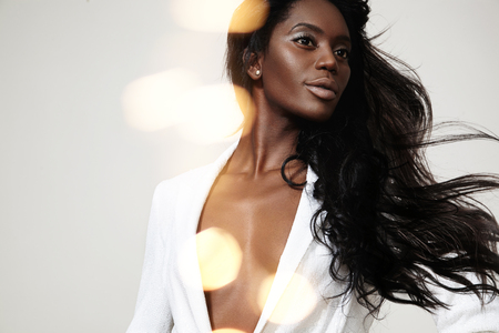 beauty black woman with a stright blowing hair and bokeh photo