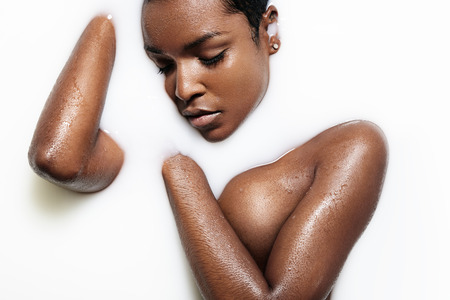 body milk: blak woman hae a milk bath