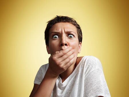 expression: shocked woman close up the mouth with hand LANG_EVOIMAGES