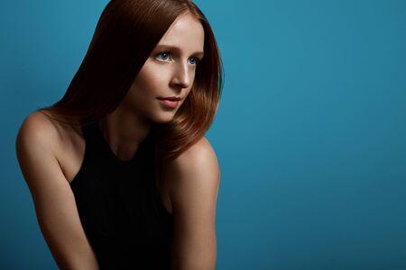 shiny: beauty redhead model with a blue eyes Stock Photo