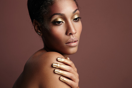 topless women: black woman with a golden makeup Stock Photo