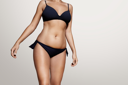 womans body wearind dark blue swimsuit Stock Photo