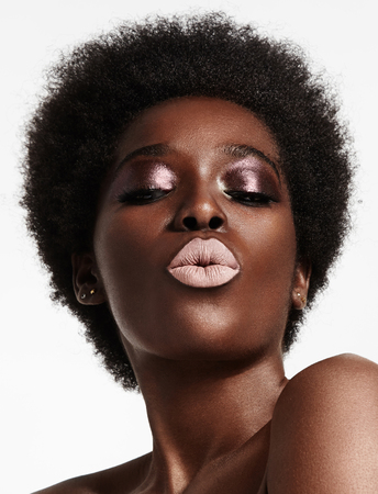 black woman with a short afra and bright lips Archivio Fotografico