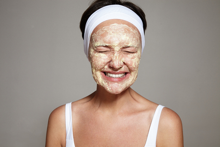 facial: woman have fun with facial routine LANG_EVOIMAGES