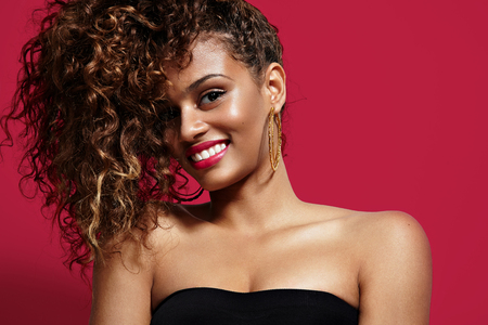 smiling beauty latin woman with curly hair Stock Photo