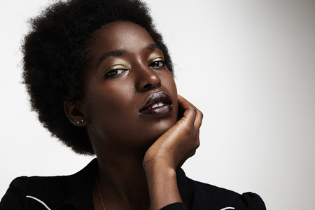 woman in black: beauty black woman with evening makeup