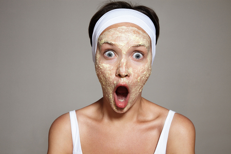 tightening: woman have fun making facial treatment LANG_EVOIMAGES