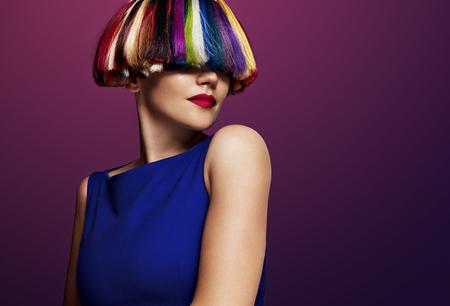 woman with a creatie color of hair. rainbow hair