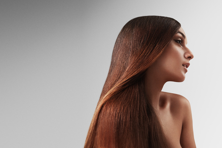 hair and beauty: beauty redhead woman. straight hair