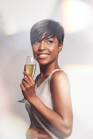 champagne glass: smiling celebrating woman with a glass of champagne