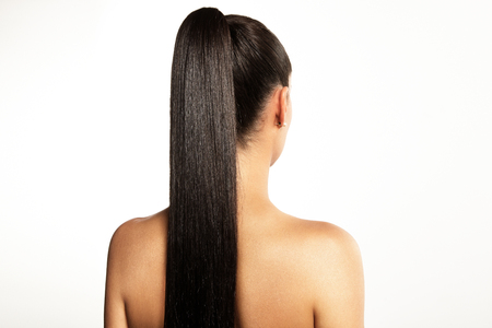 pony tail: woman with a pony tail on a white