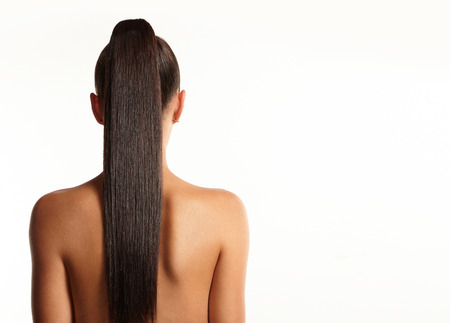 長いストレートのポニーテールの女性 写真素材