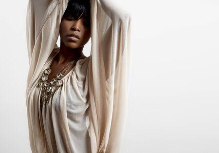 femenine: black woman wearing light shifon shirt