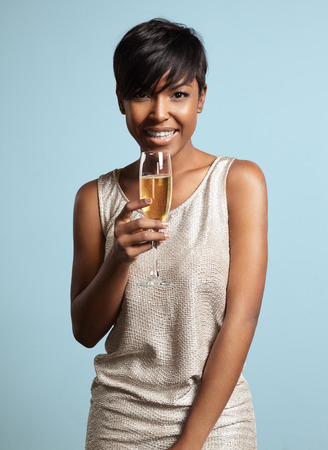 woman with a glass of champagne. Celebrating and smiling Stockfoto