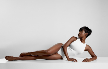 armpit hair: perfect fit black woman in white space LANG_EVOIMAGES