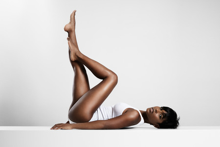 crossed legs: black woman put up her legs and crossed them