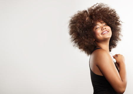 afro curly hair: happy girl with big afro hair