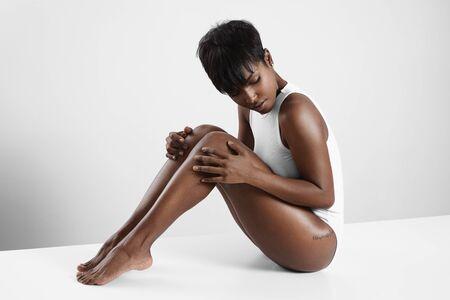 woman in black: pretty black woman in a white space