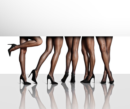 femenine: perfect shaped womens legs in a white space