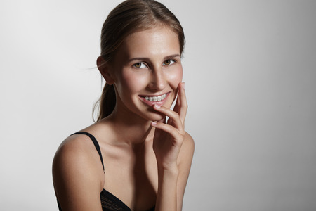 impacted: beauty young woman with braces