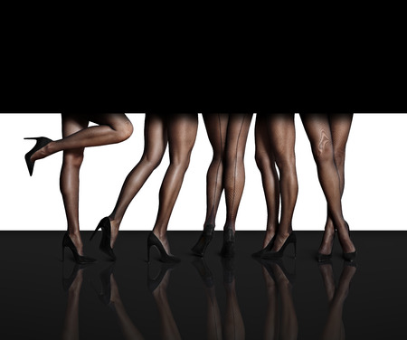 heals: womens legs in  different position in a black space