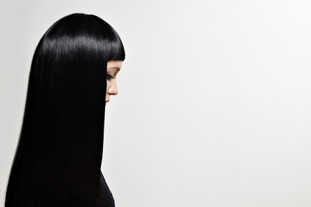 beauty woman with a long black hair in a profile Stock Photo