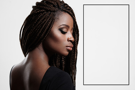 beautiful naked woman: black woman with braids and evening smokey eyes