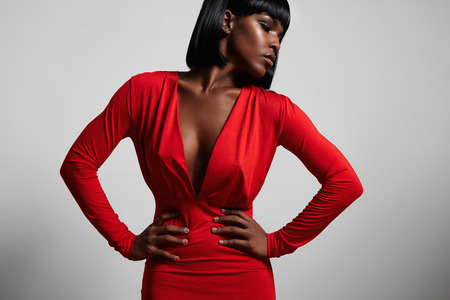 black woman wearing red dres and short hair