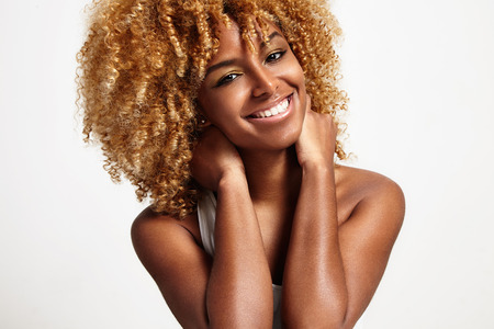 young black woman with blond curly hair