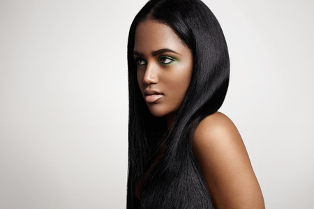 hair treatment: black woman with a straight hair