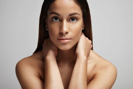 cheerless: clean skin portrait of spanish woman