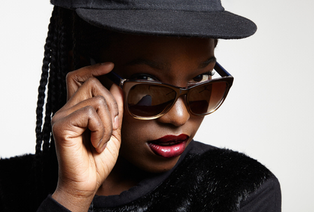 swag: closeup black womans eyes watching over glasses