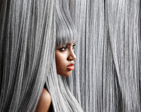 Woman's profile in trendy grey hair background