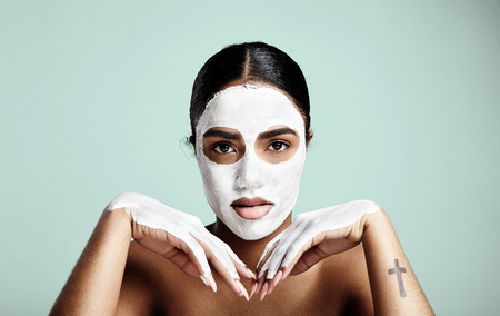 cleanse: Womans portrait making daily facial routine