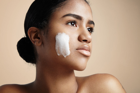 woman with a soap foam on a cheek