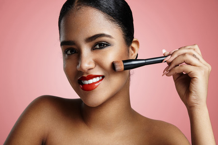 ideal foundation concept. woman with a brush for base