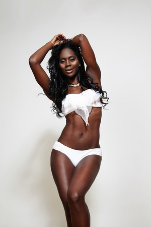 black woman in swimsuit with ideal body photo