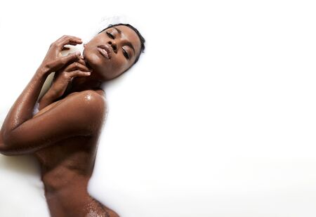 woman in bath: black woman in a milky bath LANG_EVOIMAGES