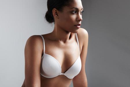 black bra: black woman in a basic white bra
