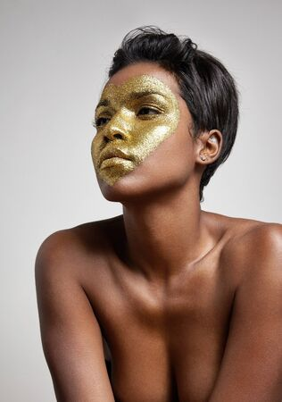 black makeup: woman with a glitter heart on a face