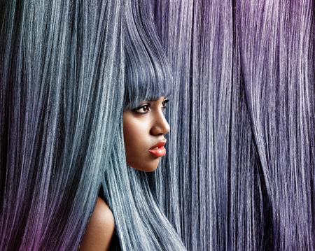 fair complexion: womans profile in trendy colour hair background